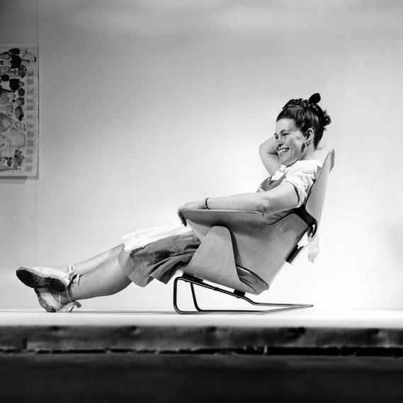 Ray Eames sitting on an experimental lounge chair, 1946 © Eames Office LLC