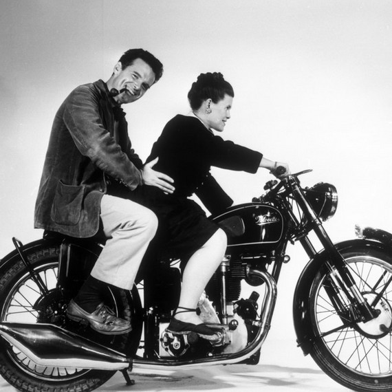 Charles and Ray Eames posing on an Velocette motorcycle, 1946 © Eames Office LLC
