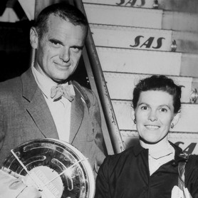 Charles and Ray Eames leaving for Moscow with the film reels of 'Glimpses of the U.S.A' in hand, 1959, © Eames Office, LLC, photographer unknown